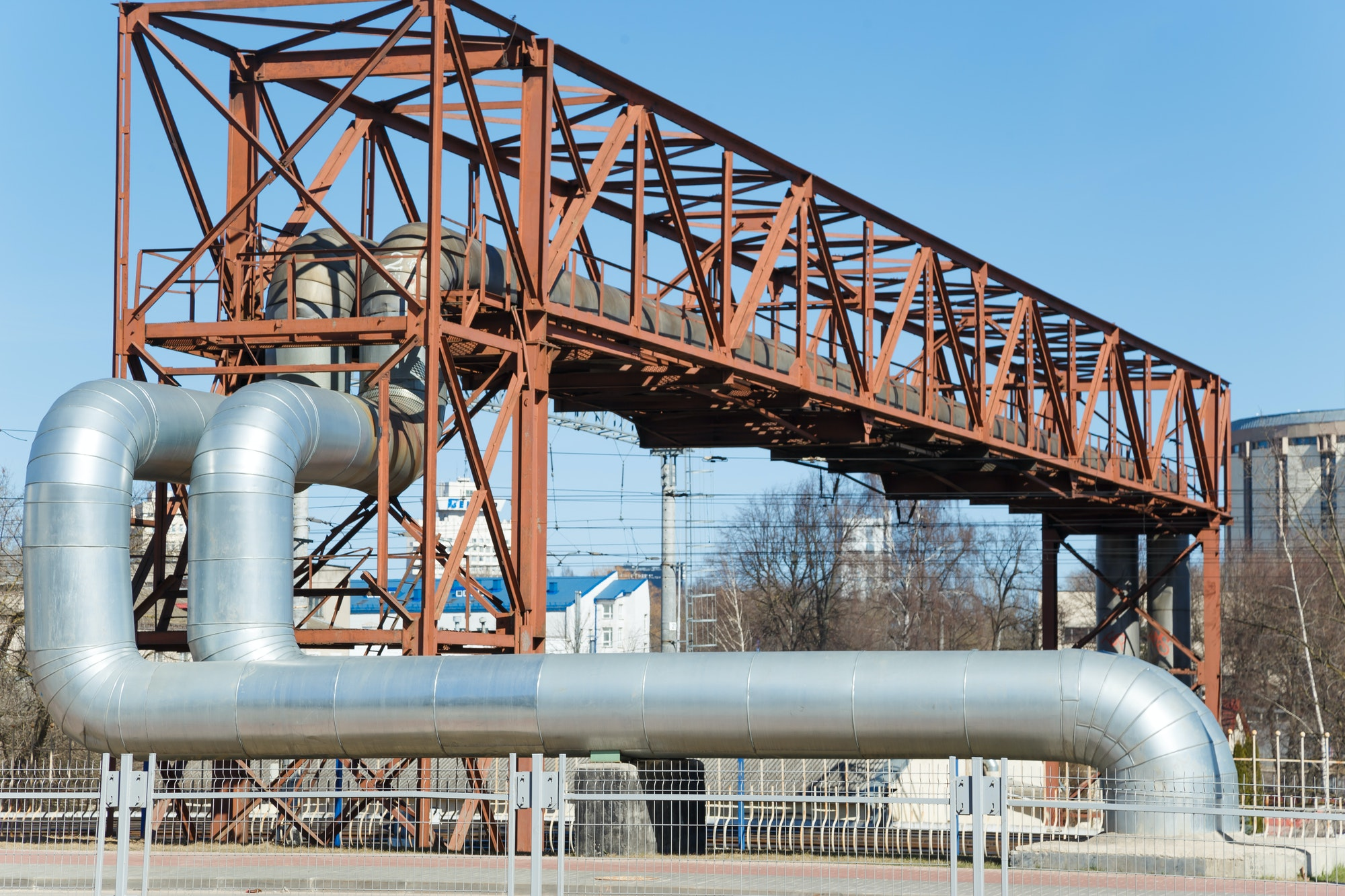 Industrial huge pipes on metal viaduct outdoor